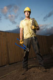 Construction Worker with Bolt Cutters and Chain Stock Photo