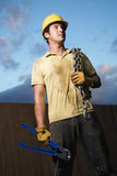 Construction Worker with Bolt Cutters and Chain Stock Photos