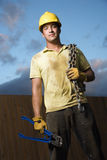 Construction Worker with Bolt Cutters and Chain Stock Images