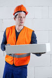 Construction worker with a brick Stock Photos