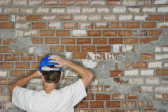 Construction Worker By Brick Wall Royalty Free Stock Photography