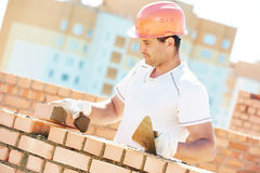 Construction worker bricklayer Stock Images
