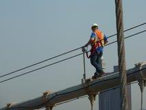 Construction worker on Brooklyn Bridge stock photo