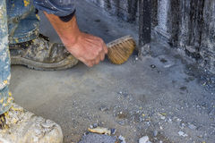 Construction Worker with broom sweeping concrete 2 Royalty Free Stock Photo