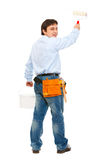 Construction worker with bucket and brush painting Stock Photos