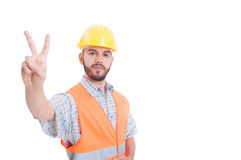 Construction worker, builder or engineer showing peace or victor Royalty Free Stock Photos