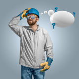 Construction worker builder in helmet thinking with speech bubble royalty free stock images