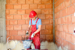 Construction worker, builder, working on construction site. Royalty Free Stock Image