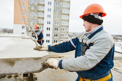 Construction worker. Builders concreter joiners at work Royalty Free Stock Photo