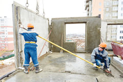 Construction worker. Builders concreter joiners at work Stock Images