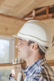 Construction worker building house Stock Photography