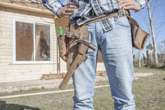 Construction worker building house Stock Images