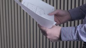 Construction worker and building plans, architect or engineer looking and examining blueprints of new houses and. Apartments stock video footage