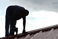 Construction Worker Building Roof Stock Photo