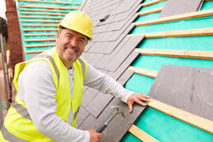 Construction Worker On Building Site Laying Slate Tiles Royalty Free Stock Images