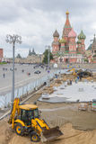 Construction worker building street at St. Basil's Cathedral f Royalty Free Stock Photography