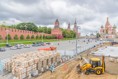 Construction worker building street at St. Basil's Cathedral f Stock Image