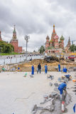Construction worker building street at St. Basil's Cathedral f Royalty Free Stock Images