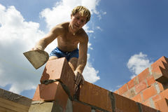 Construction worker building a wall. Of a house Stock Photos