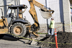 Construction worker bulldozer fixing street Royalty Free Stock Photo