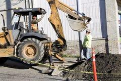 Construction worker bulldozer fixing street Royalty Free Stock Photo