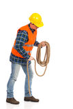 Construction worker bundle rope. Construction worker holds a rope. Full length studio shot isolated on white Stock Photo