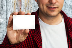 Construction worker with business card Stock Photo