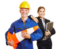 Construction worker and business woman as a team Royalty Free Stock Photography