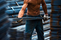 Construction worker carry steel Stock Image