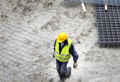 Construction worker carrying armature Stock Photos