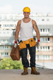 Construction Worker Carrying Brick Royalty Free Stock Photo