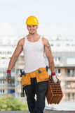 Construction Worker Carrying Brick Royalty Free Stock Images