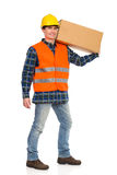 Construction worker carrying carton box on his shoulder. Royalty Free Stock Images