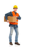 Construction worker carrying package. Stock Image