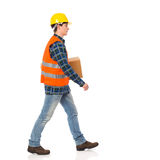Construction worker carrying package. Royalty Free Stock Image