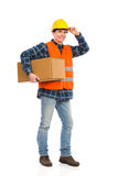 Construction worker carrying package. Royalty Free Stock Photography