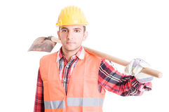 Construction worker carrying a shovel on shoulder Royalty Free Stock Image