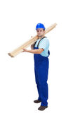 Construction worker carrying wooden plancks stock photos