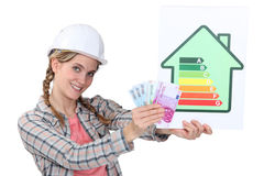 Construction worker with cash Stock Photos