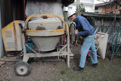 Construction worker with cement mixer Stock Photo