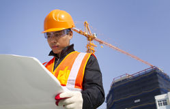 Construction worker with crane in background Royalty Free Stock Photography