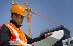 Construction worker with crane in background Royalty Free Stock Images