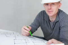 A construction worker checking documents Stock Image