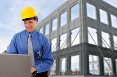 Construction Worker Checking Laptop at Site Royalty Free Stock Images