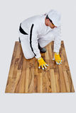 Construction worker checks a wooden floor Royalty Free Stock Photo