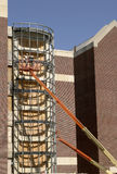 Construction Worker in a Cherry Picker. Working on a building renovation Stock Image
