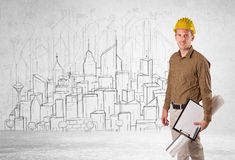 Construction worker with cityscape background Stock Photo