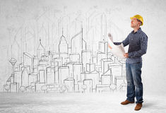 Construction worker with cityscape background Stock Photography