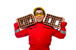 The construction worker with clay bricks on white Stock Photography