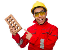 The construction worker with clay bricks on white Royalty Free Stock Photos